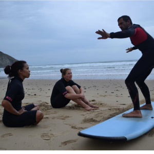 Students learn to surf after a long week of veterinary experience in South Africa