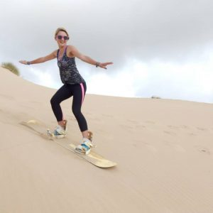 Vet students try sandboarding in their free time after a long week of veterinary experience in South Africa